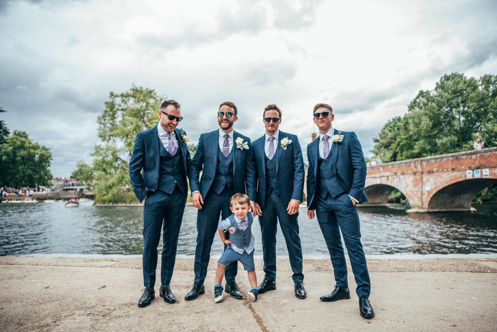 Page boy pulls face in Groomsmen group Essex Documentary Wedding Photographer