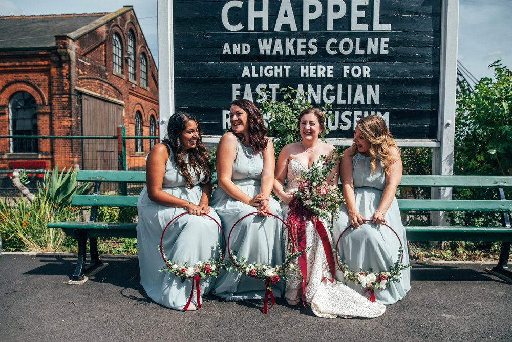 Bride and Bridesmaids on platform at East Anglian Railway Museum Essex Documentary Wedding Photographer
