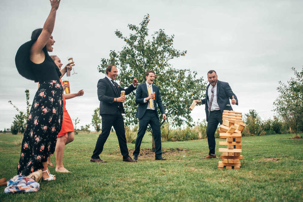 Wedding guests knock over giant Jenga Essex Documentary Wedding Photographer