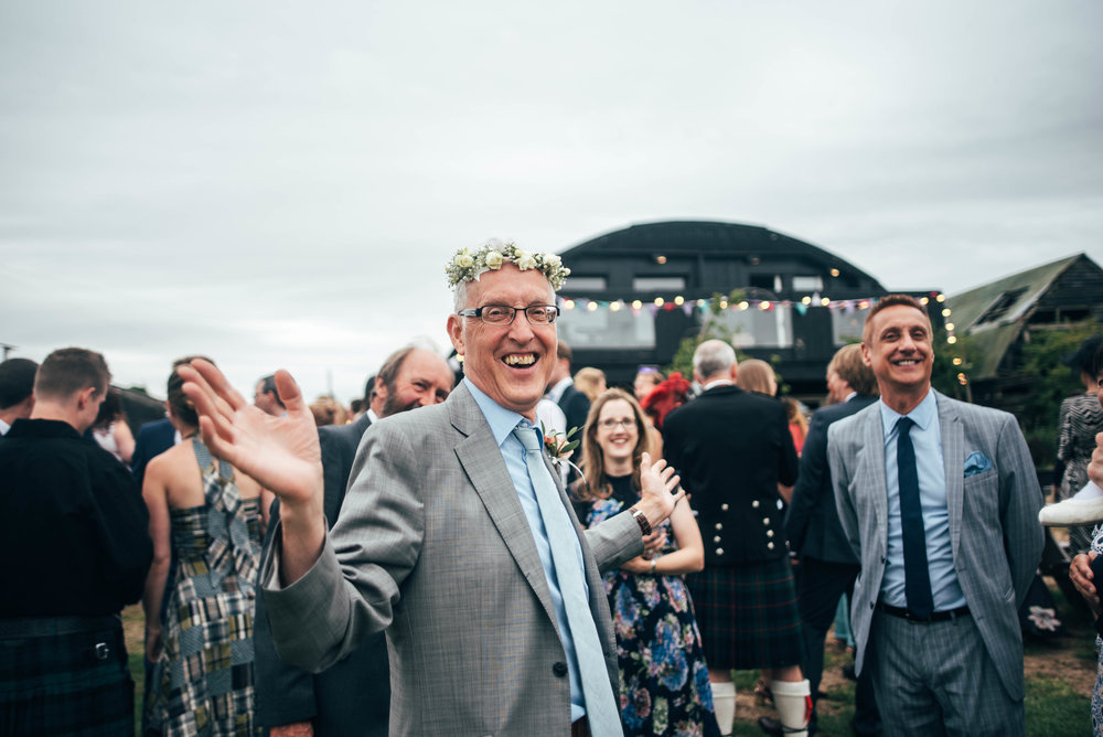 Father of Bride wears Flower Crown at Bedinghams Farm, Ely Essex Documentary Wedding Photographer