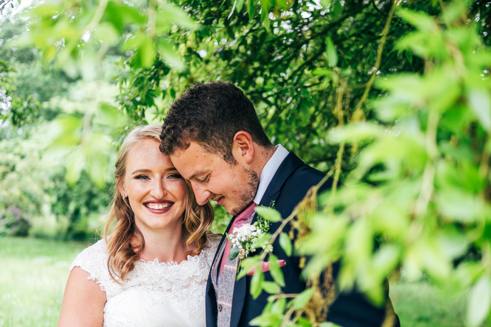 Bride and Groom in garden at Blake Hall, Ongar Essex Documentary Wedding Photographer