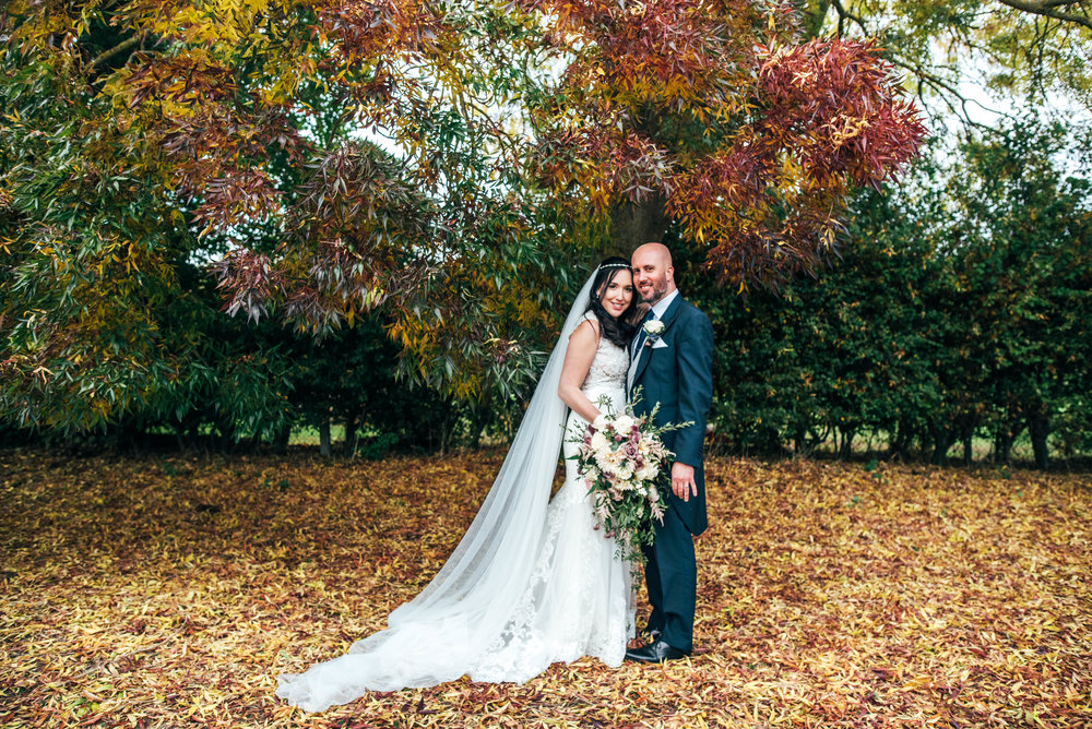 Bride and Groom under Autumn Tree Essex Documentary Wedding Photographer