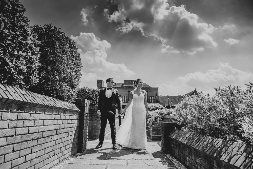 Bride and Groom under big summer sky at Stock Brook Manor, Billericay, Essex Documentary Wedding Photographer