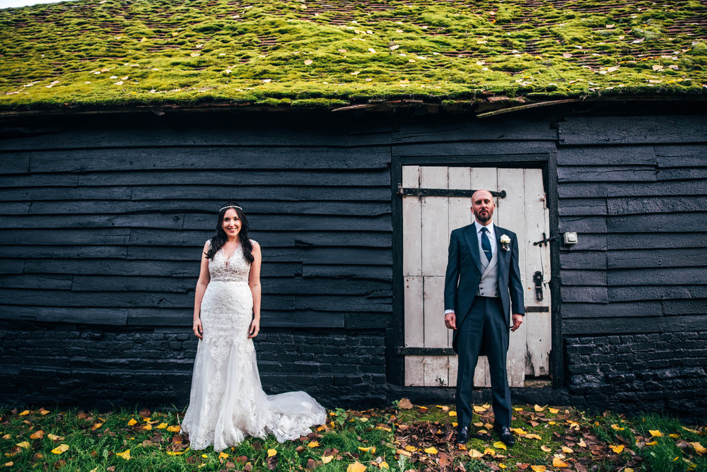 Bride and Groom outside barn, Barn Brasserie, Great Tey, Essex Documentary Wedding Photographer