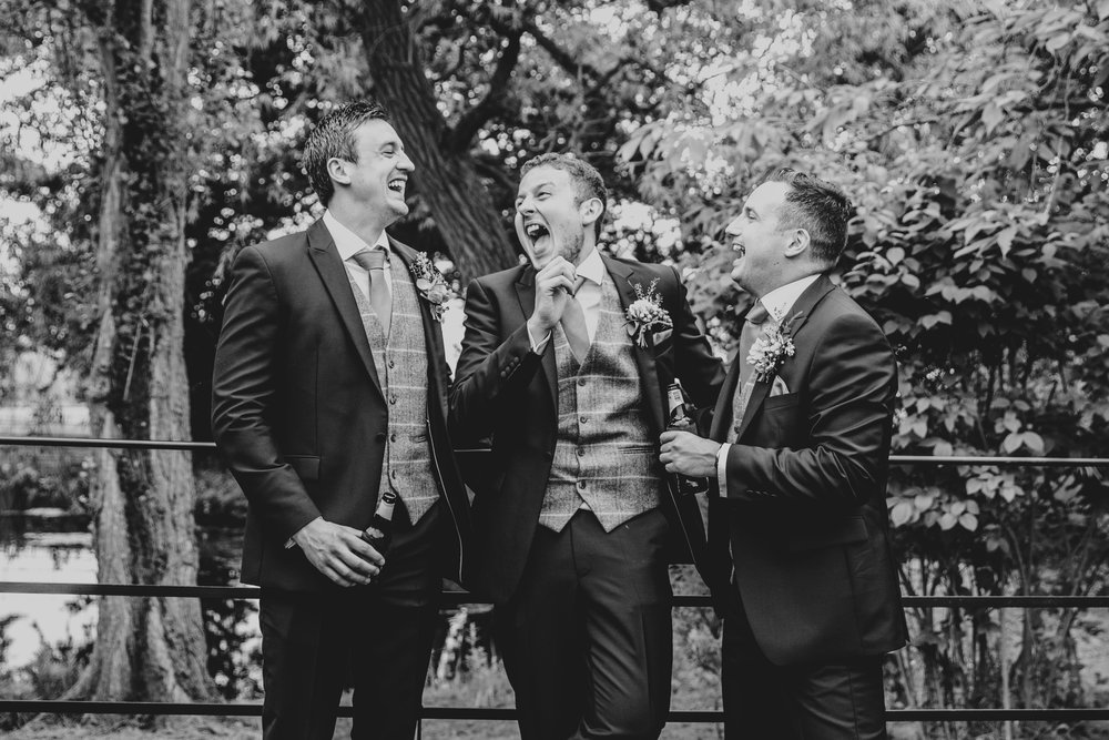 Groom laughs with Groomsmen Blake Hall, Ongar, Essex Documentary Wedding Photographer