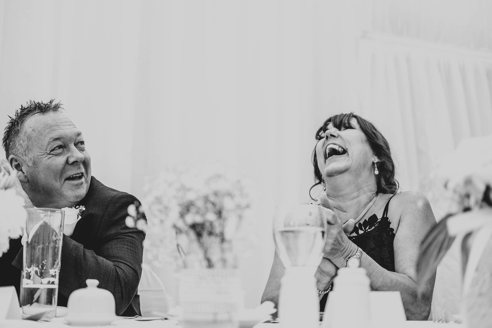 Grooms Mum laughs at speeches, Parklands, Quendon Hall, Essex Documentary Wedding Photographer
