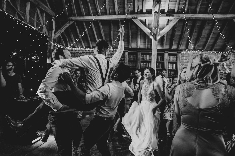 Wedding guests hit the dance floor at The Long Barn.  Essex Documentary Wedding Photographer