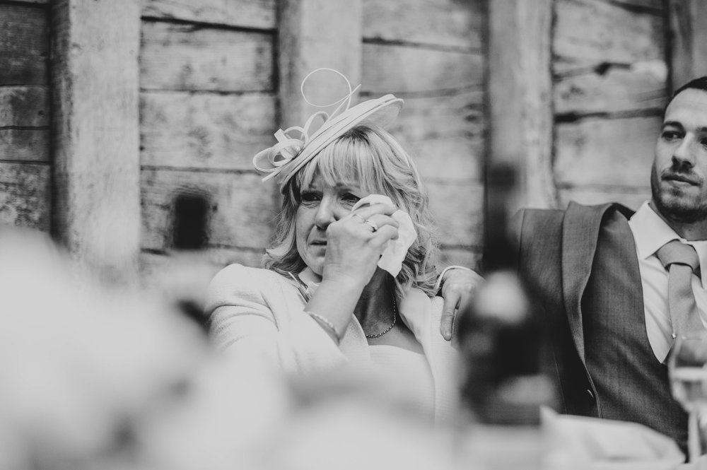 Mother of Groom wipes away tear at speeches Blake Hall, Ongar, Essex Documentary Wedding Photographer