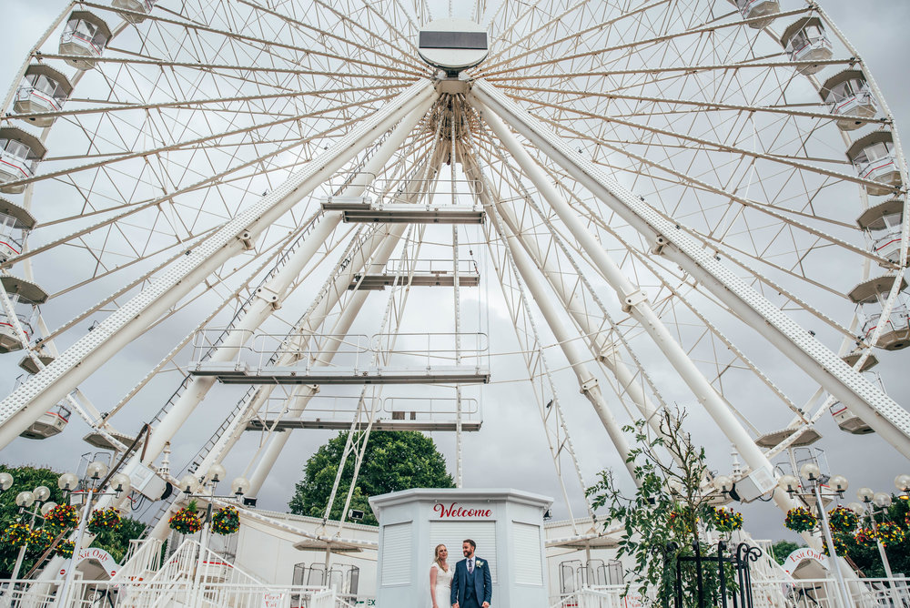 Bride and Groom in front of Big Wheel, Essex Documentary Wedding Photographer