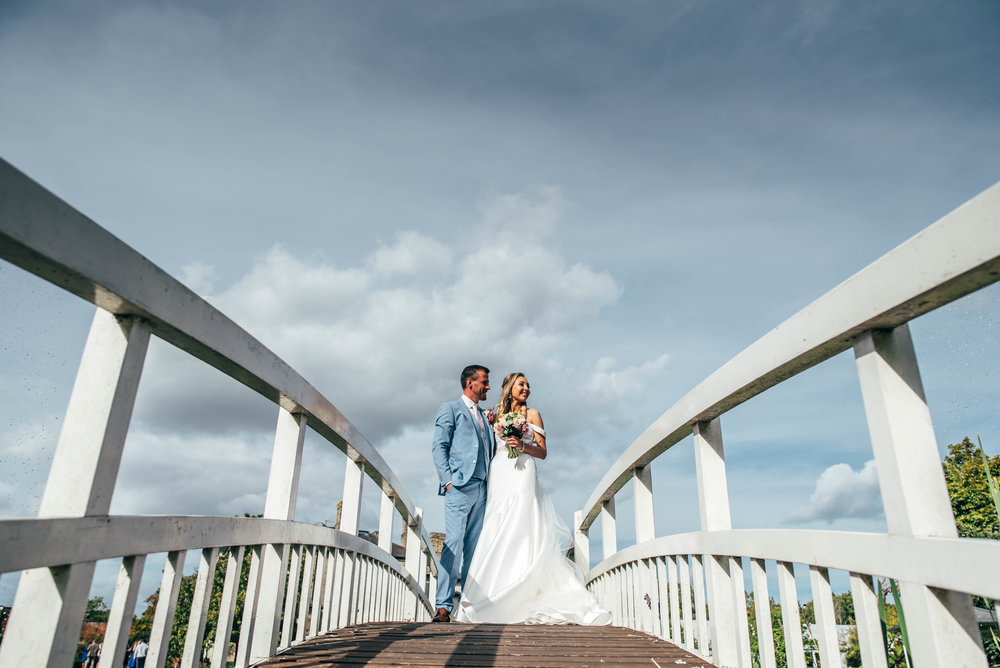 Bride and Groom on bridge at Fennes, Braintree, Essex Documentary Wedding Photographer