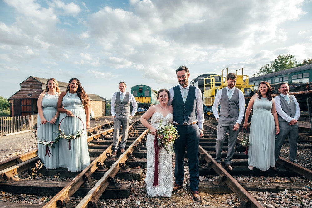 Bride and Groom with Bridal party on train tracks at East Anglian railway Museum, Essex Documentary Wedding Photographer