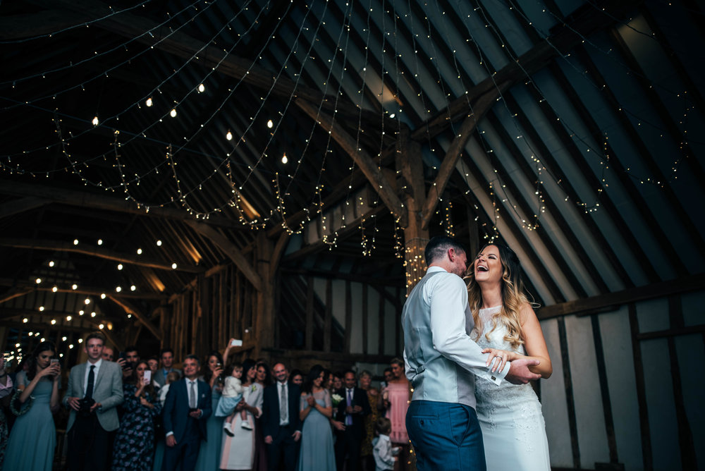 Bride laughs during First Dance at Blake Hall, Ongar, Essex Documentary Wedding Photographer