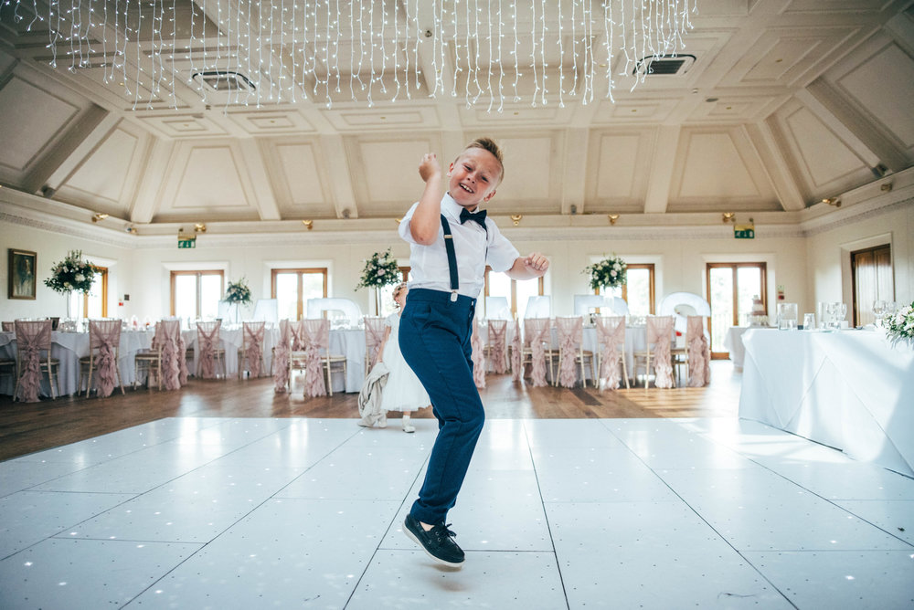 Page Boy on dance floor at Stock Brook Manor, Billericay, Essex Documentary Wedding Photographer