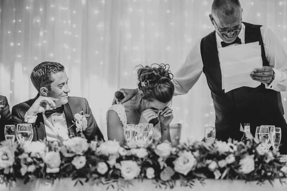 Father of Bride comforts Bride during speeches at Stock Brook Manor, Billericay, Essex Documentary Wedding Photographer
