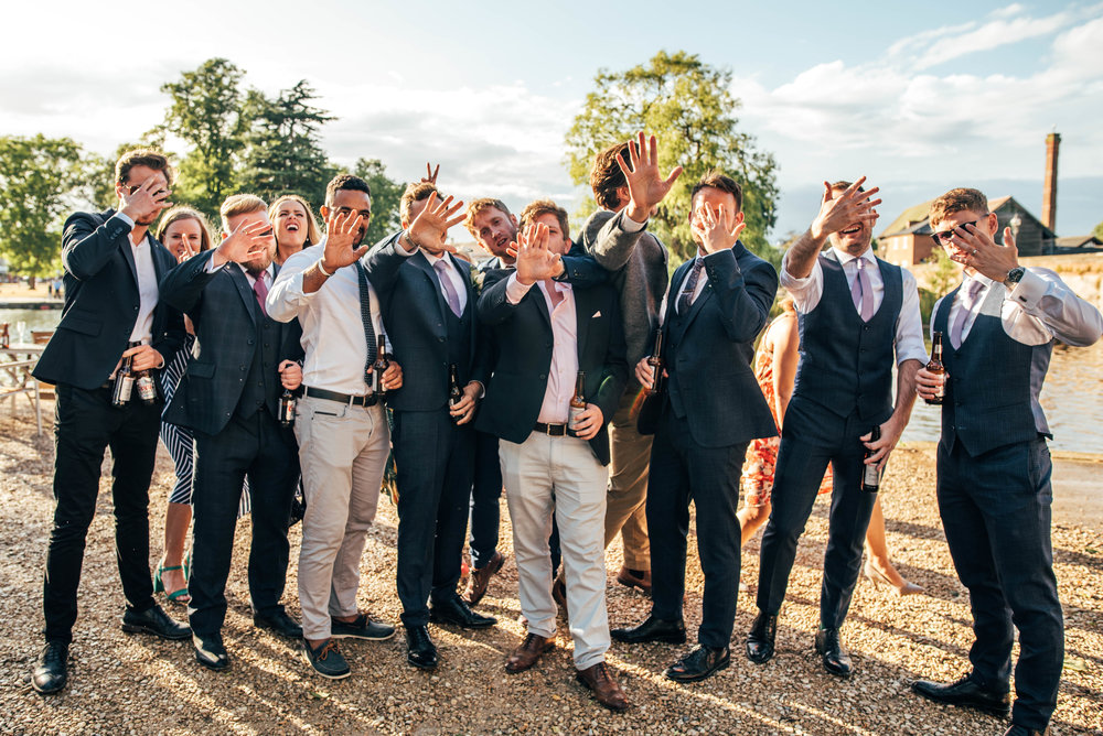 Wedding guests hide faces, Essex Documentary Wedding Photographer