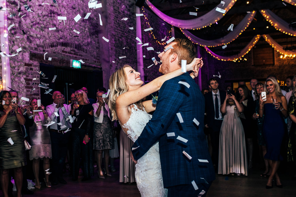 Bride and Groom First Dance, Confetti Canon at The Granary Estates, Woodditton.  Essex Documentary Wedding Photographer