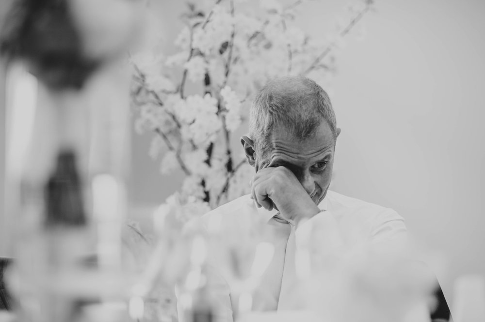 Father of Groom cries during speeches, at Fennes, Braintree, Essex Documentary Wedding Photographer