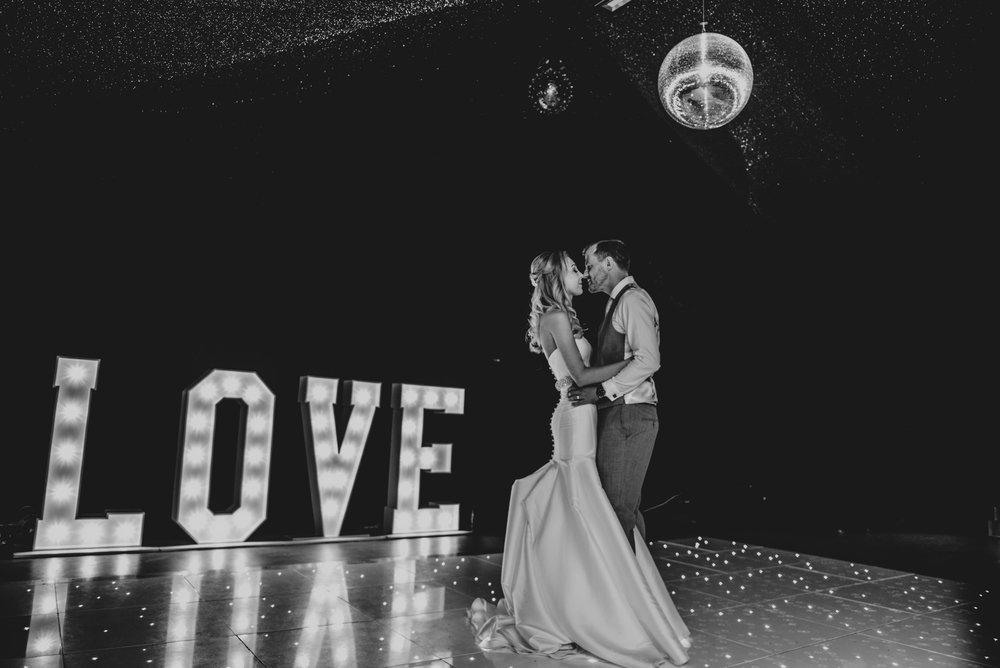 Bride and Groom First Dance with Marquee Lights at Fennes Braintree Essex Documentary Wedding Photographer