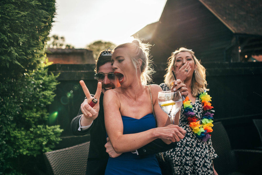 Playful Wedding Guests during evening reception at Gaynes Park Epping, Essex Documentary Wedding Photographer