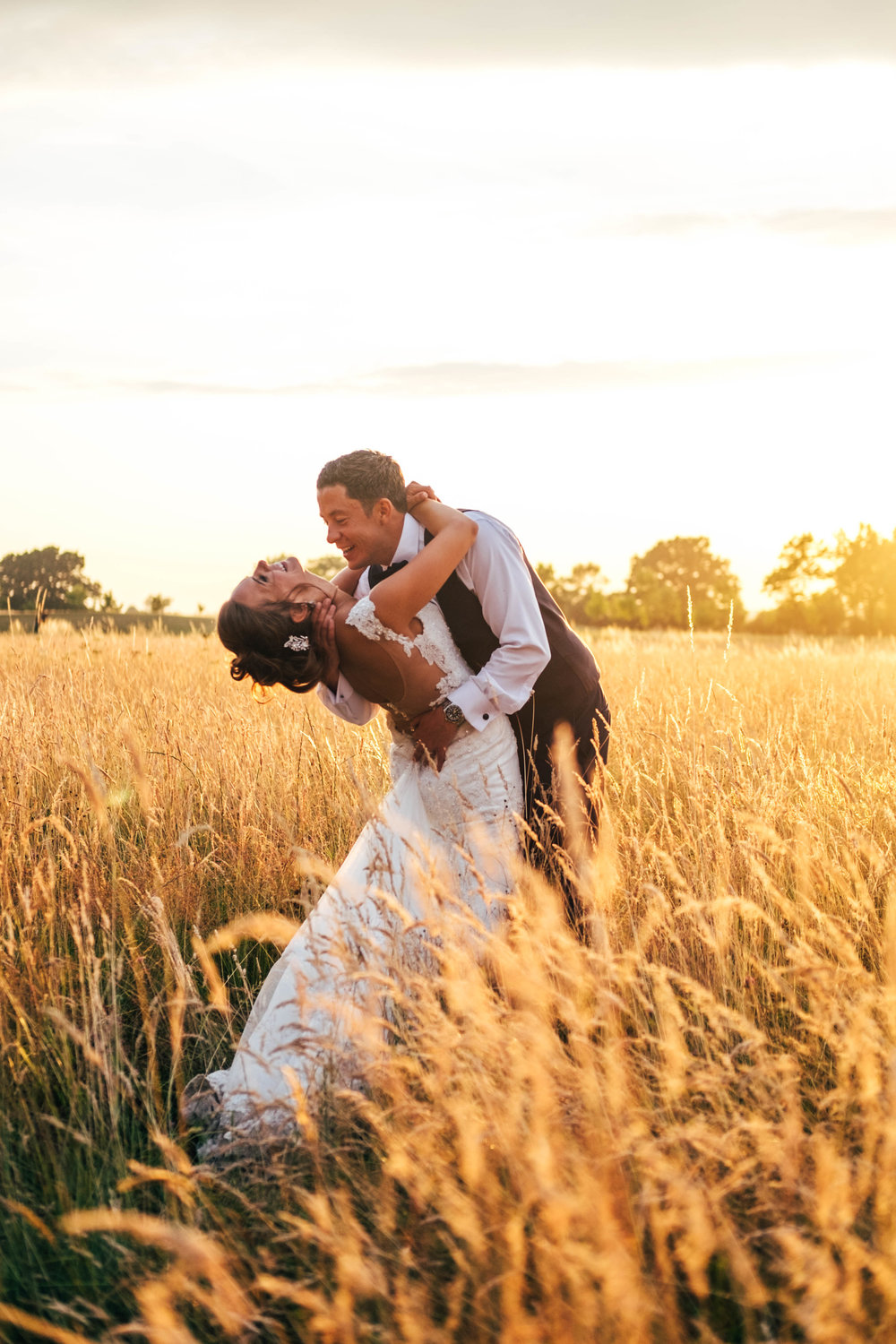 Bride & Groom in cornfield at Sunset Stock Brook Manor Billericay Essex Documentary Wedding Photographer