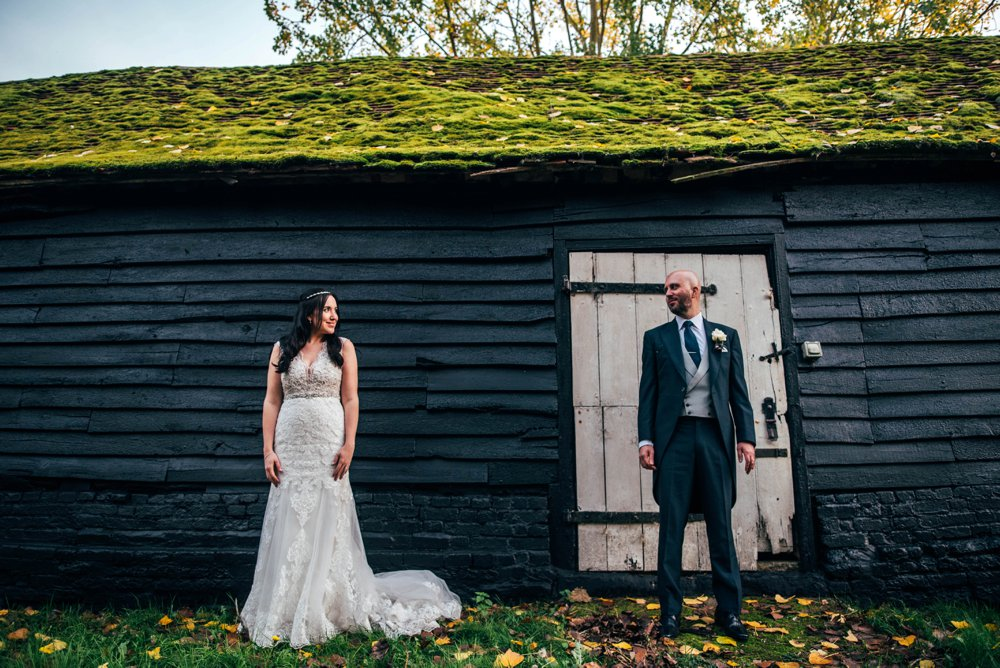 Rustic Autumn Muted Blues & Pinks at The Barn Weddings Great Tey, Chappel Viaduct. Essex Documentary Wedding Photographer