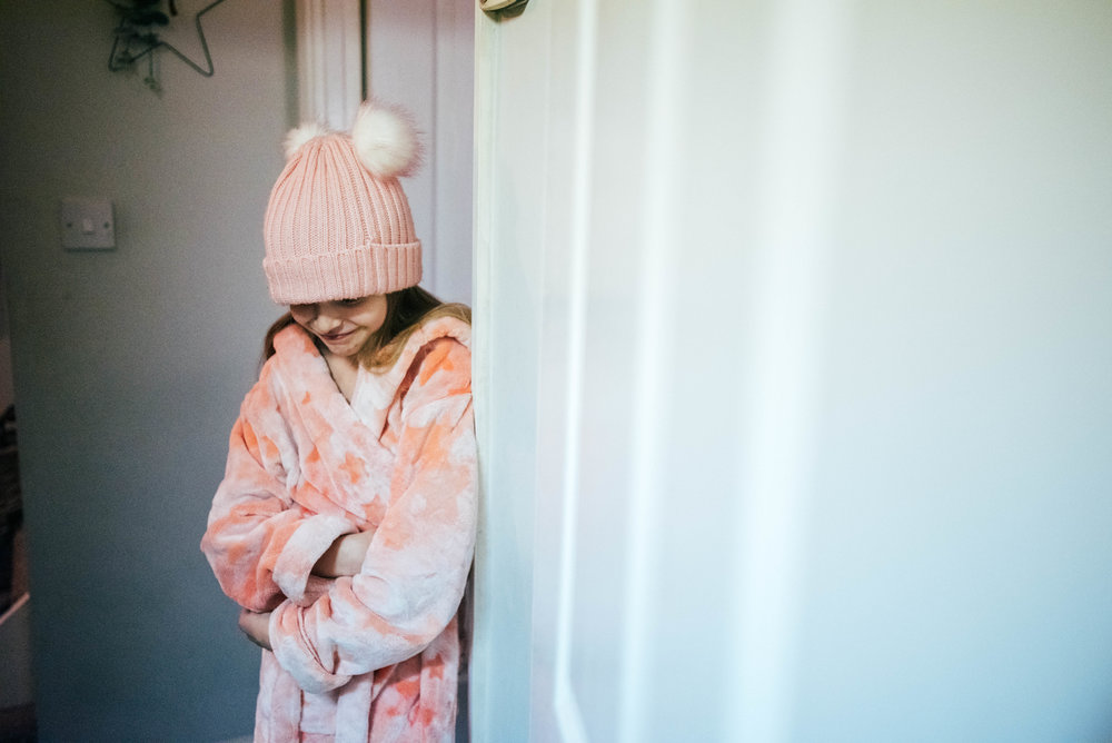 Girl in pink bobble hat. Essex Documentary Wedding & Portrait Photographer