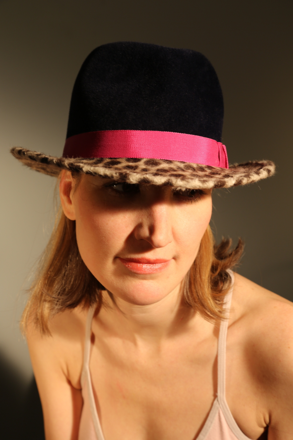 Navy and leopard print felt hand shaped trilby with pink trim.JPG