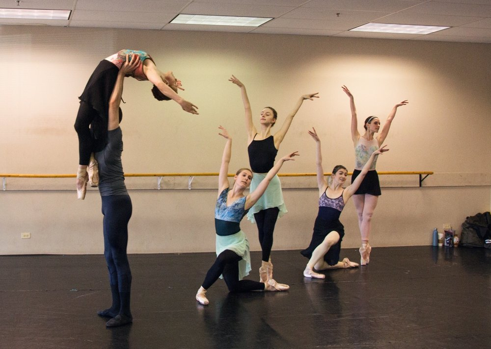 Laura Peterman (Center, kneeling) with artists of the company rehearsing  Shades of Refrain .