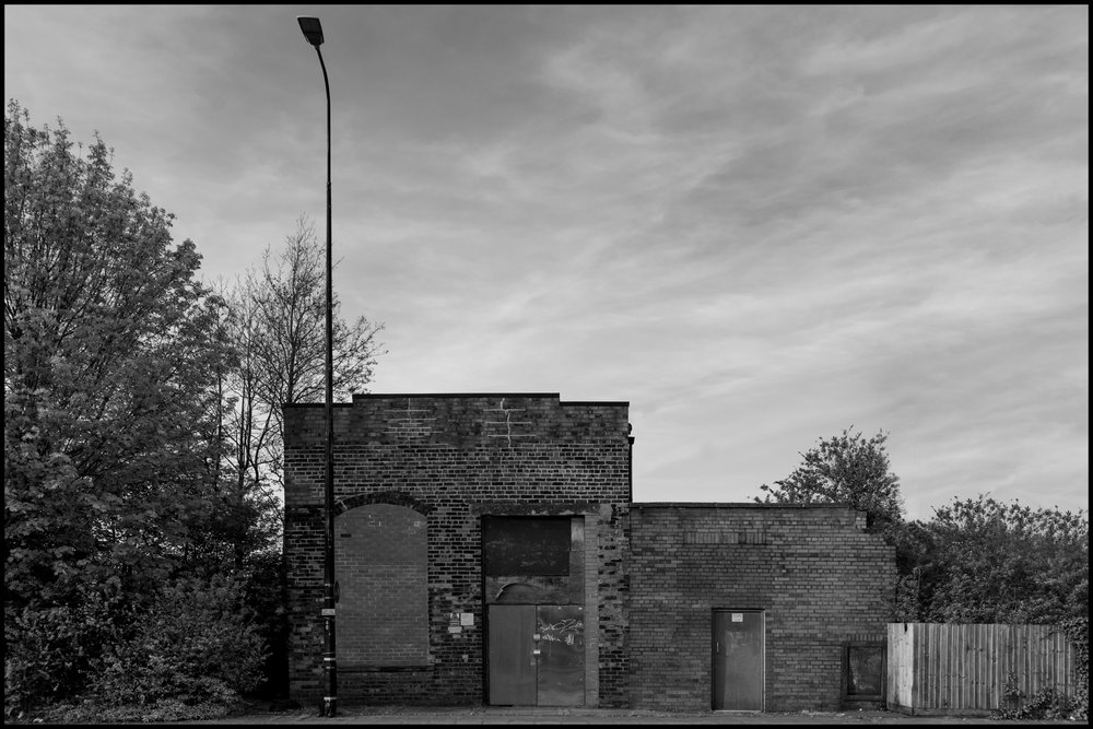 19 April 2019 - Old house and a street lamp, Salford UK