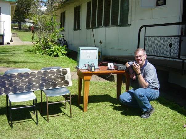 My dad, John Price, being a baller with his solar cookers he used for chemistry classes.