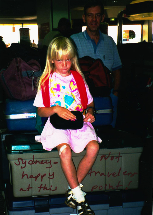 Me sitting on all of our footlockers in the airport on the way back to America and generally hating life.