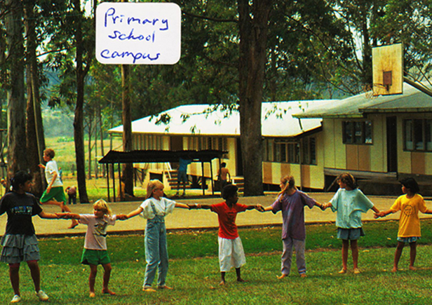 Students at the old primary school playing red rover. Photo: Kirk Franklin (postcard)