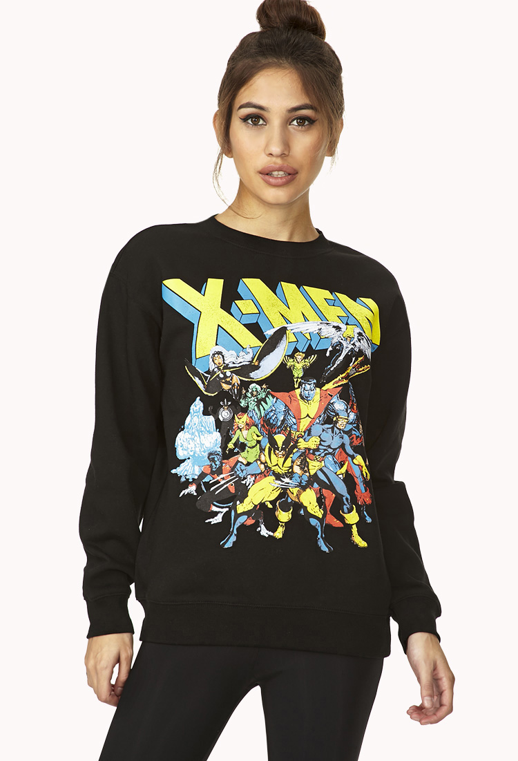 This dumb trendy shit-head is advertising X-men for Forever 21 however, the uniform of Wolverine is not totally accurate. He sported this yellow and blue  popular by the 1992 X-Men animated series. Although Wolverine did adorn the yellow and blue in 1970s but with smaller ears and less aggressive-look. Point is even Marvel Girl is in this print and definitely that uniform was 1960s Golden Era.  (this photo belongs to Forever 21) screw you guys.