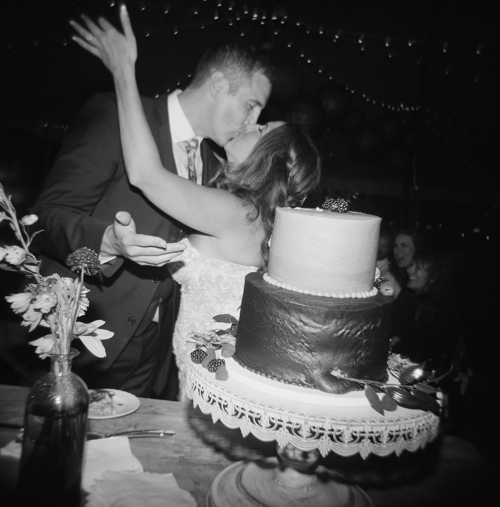door county weddings black and white cake cutting film photography