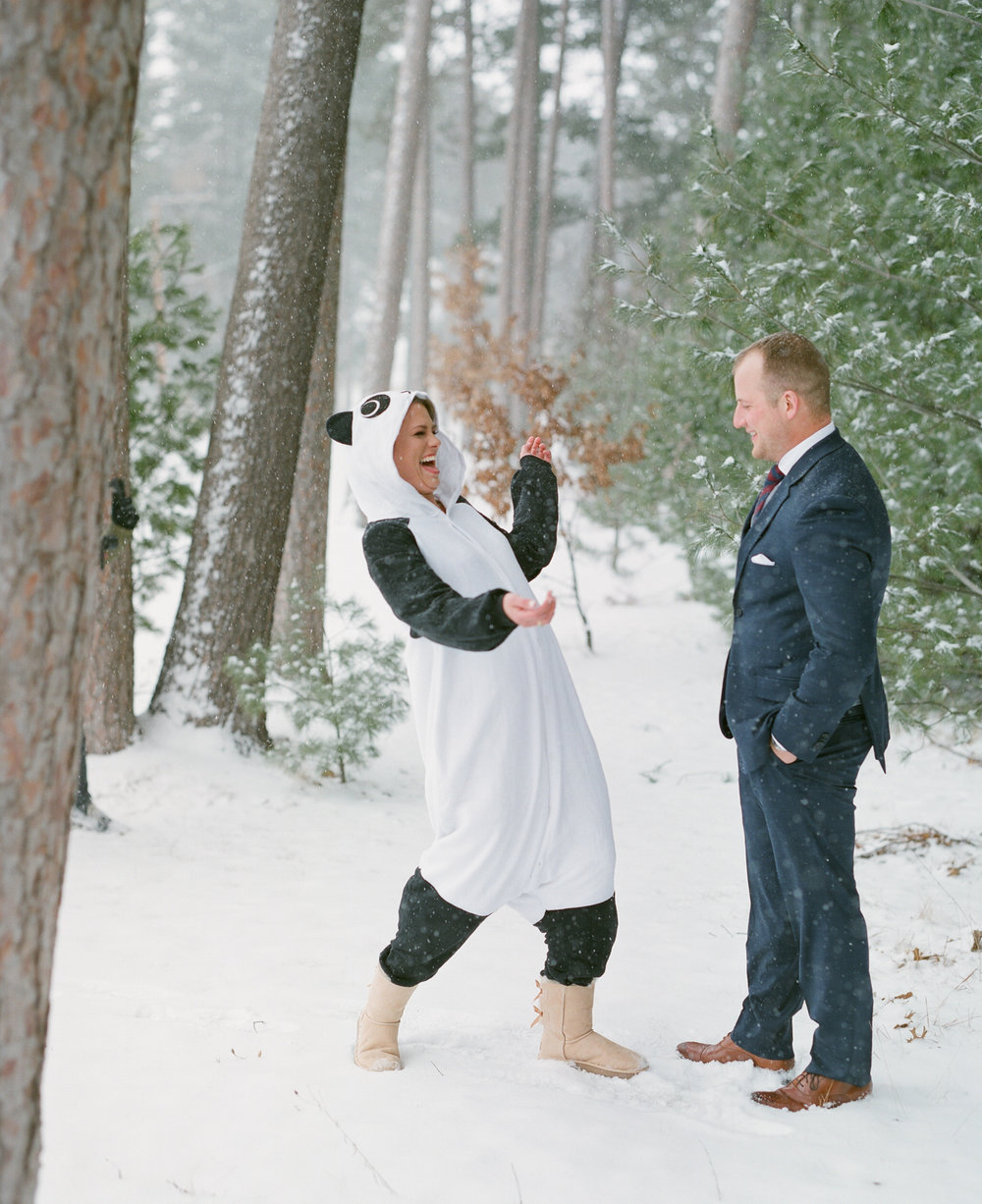 Bride wearing funny costume for first look with groom on her wedding day