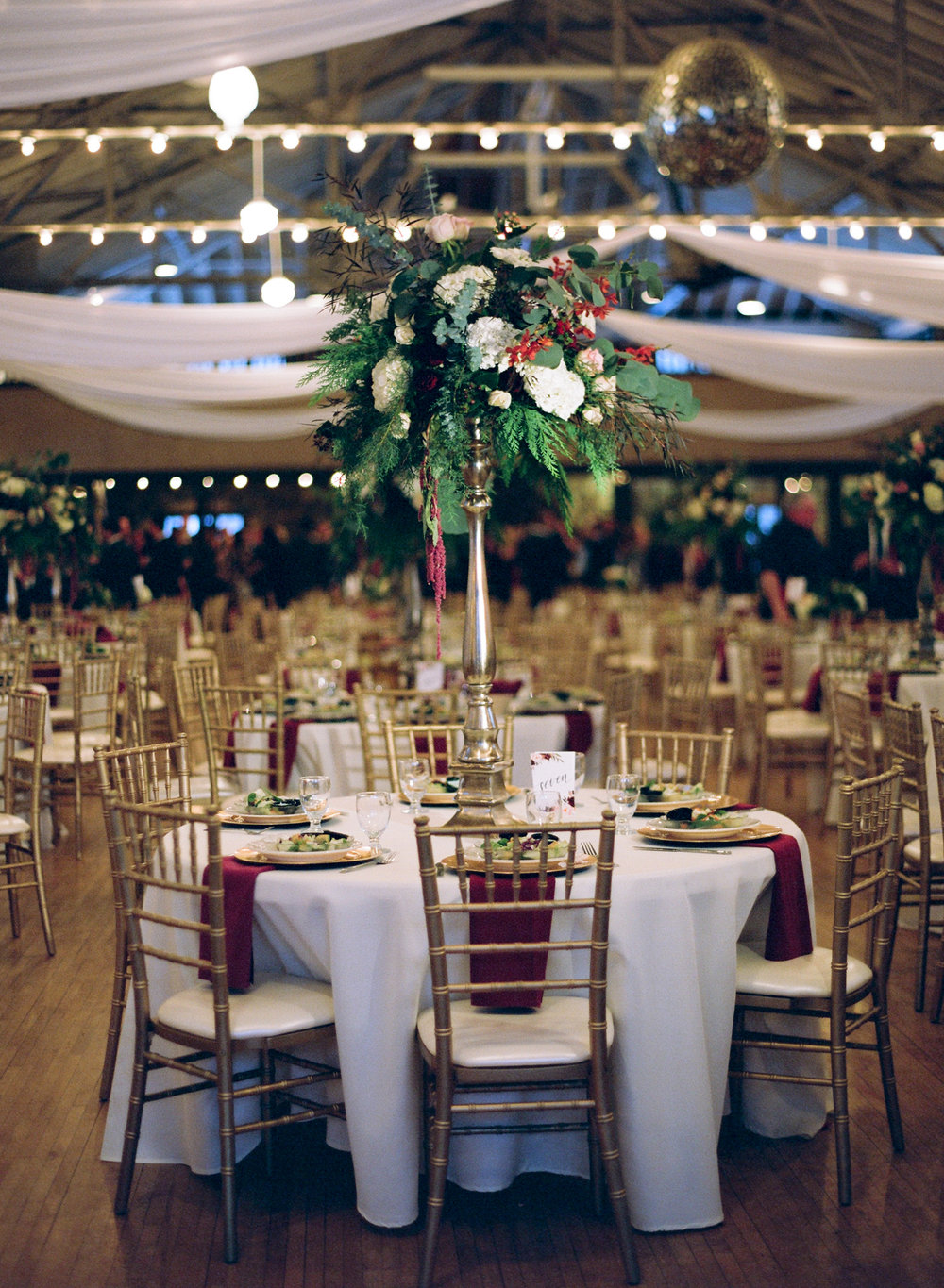 Burgundy and gold decor at Rothschild Pavilion winter wedding reception