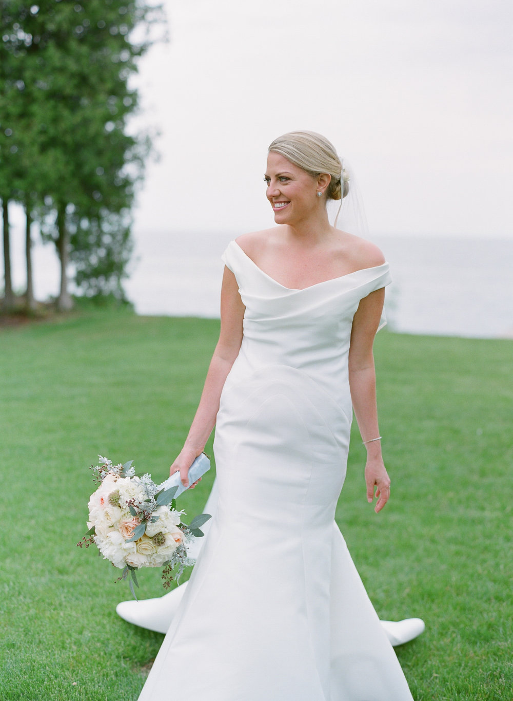 Door County bride portrait on the water