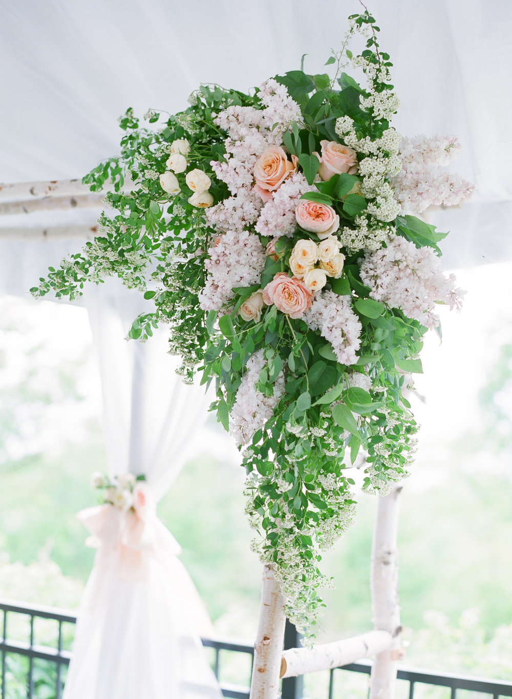 Floral arbor at Horseshoe Bay Golf Club door county wedding