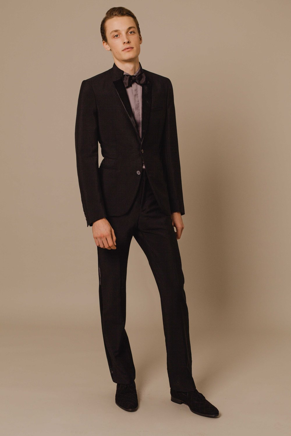 Contemporary tuxedo black with shaved lambskin lapel Tuxedo trousers black with shaved lambskin side stripe Hand made in London  Classic shirt grey Made in Italy