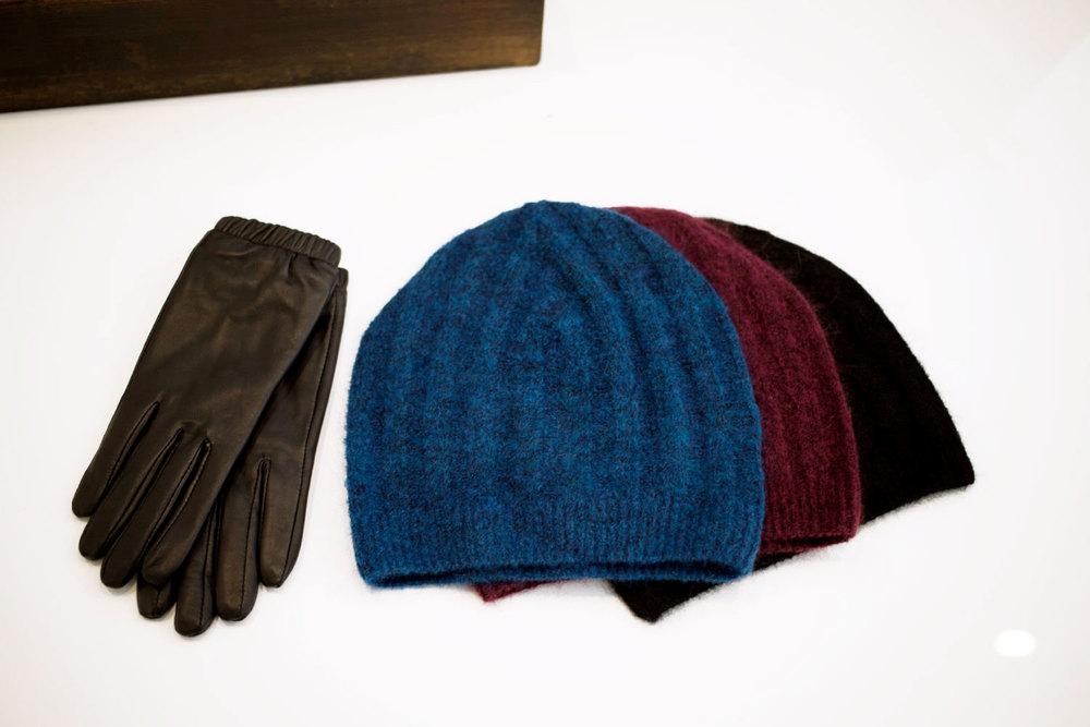Above: Just Female Stall Leather Gloves and Glow Beanies in Blue, Aubergine and Black.