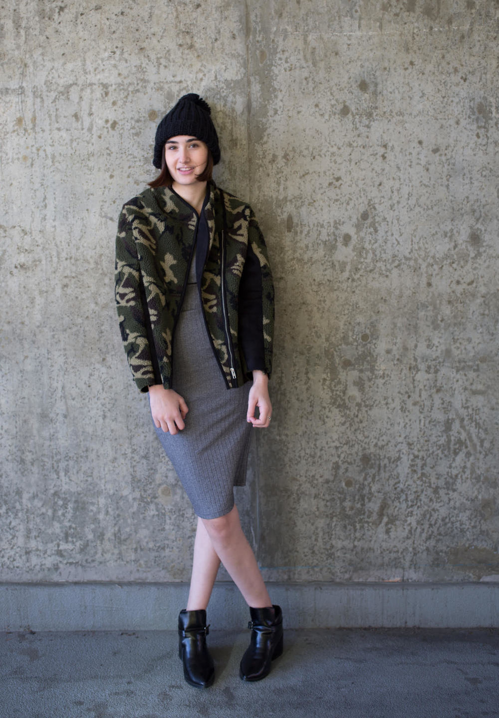 Wearing the BLQ  Bow Shearling Camo  Jacket, Knot Sisters ribbed body con dress, and Pipe and Row Staples Oversized Pom Beanie.