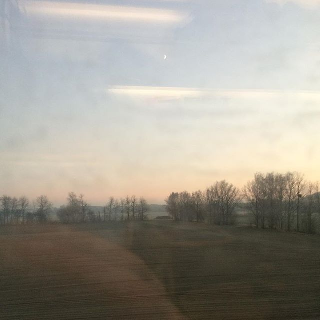 Dusk on the German countryside. #sunset #moon #winter #train #nofilter