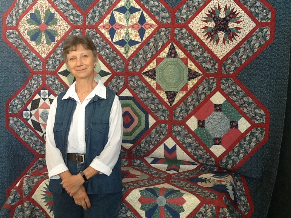"Fran Kordek,  Quilt Artist, of   ""Only Nine Pairs.""   Fran donated this handmade quilt to The Arts Center. Only Nine Pairs appraises between $2 and $4 thousand and has received numerous accolades including: West Virginia Culture Center Juried Exhibit, 2002, Mid-Atlantic Quilt Festival, Williamsburg, WV, 2003, American Quilter's Society (AQS), Nashville, TN, 2003, Husqvarna Viking International Convention, 2004, and this quilt was also featured in American Quilter, January, 2004"