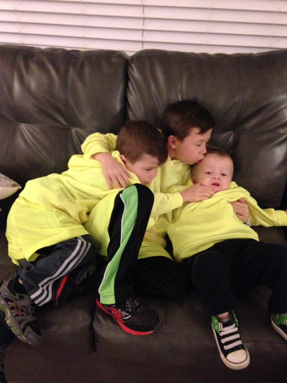 The big boys trying to comfort Everett as he cries. He wasn't in the mood for the matching sweatshirt pic.