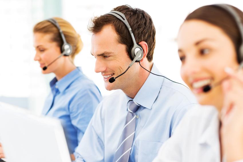 stock-photo-23805338-male-call-centre-representative-amidst-colleagues.jpg