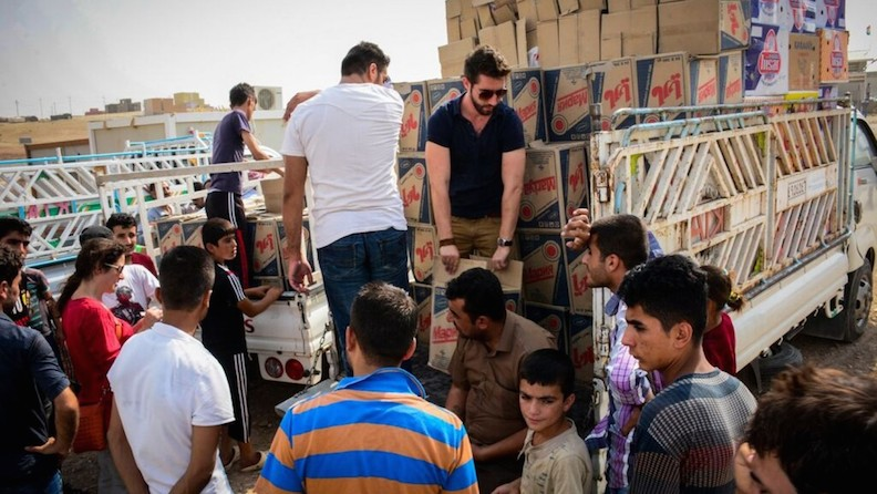 (IsraAID relief volunteers distributing supplies in Iraq last month. Photo: courtesy)