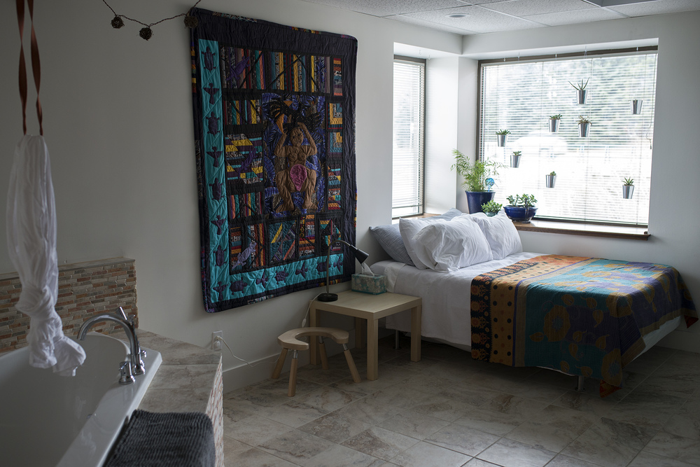 There are beautiful tubs in each room. I was particularly drawn into this space. I love the windows, the hanging plants, and the birthing tapestry.