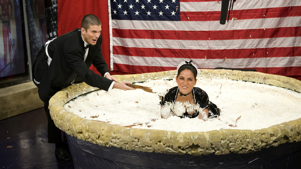 (6)  olivia-munn-and-kevin-pereira-celebrate-the-national-pie-week-initiative-by-diving-into-a-gigantic-chocolate-pie.jpg