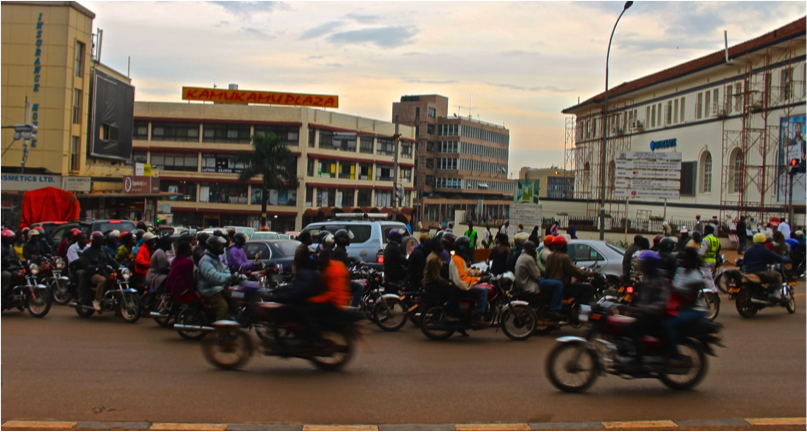Boda bodas in evening rush hour- downtown Kampala