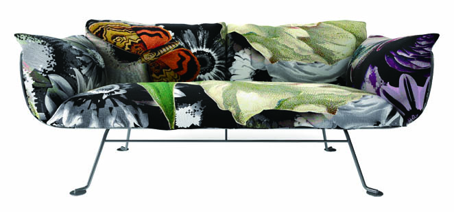 Moooi Nest Sofa 纖細的金屬支架與絢麗蓬鬆的沙發形成鮮明的對比,誇張的花朵和蝴蝶圖案是本季潮流人士的選擇。 At Livingspace, 877 683 1116 livingspace.com